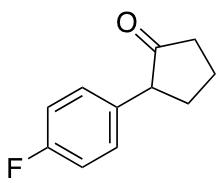 2-(4-Fluorophenyl)cyclopentan-1-one